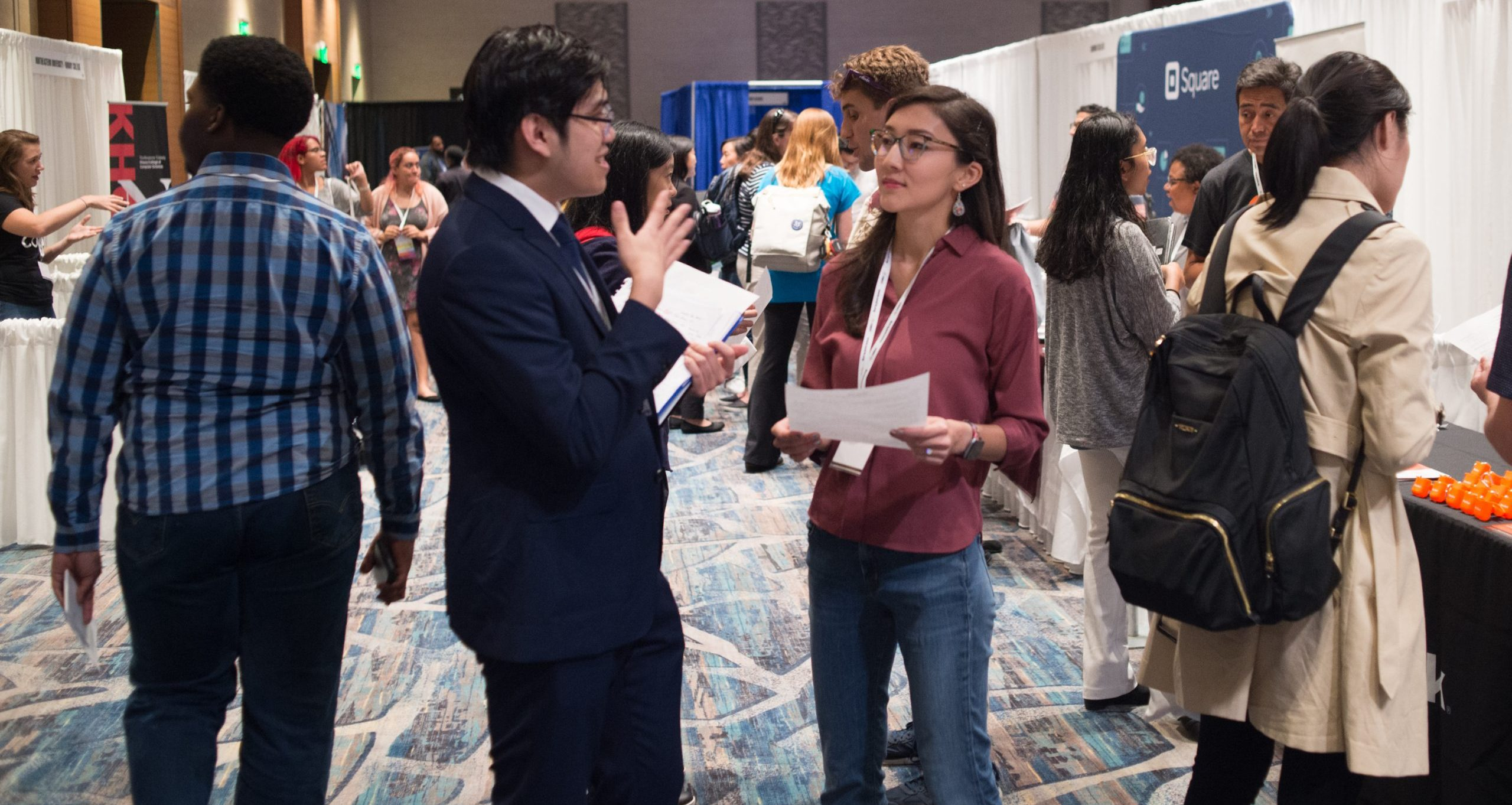 Student talking with recruiter at 2019 Tapia Career Fair